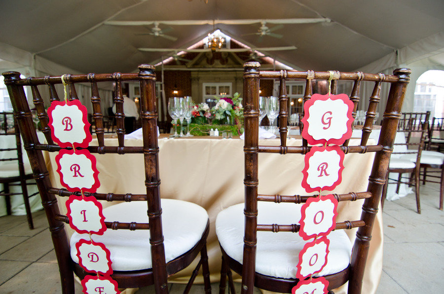 Tented-wedding-reception-bride-groom-chairs-at-sweetheart-table.original