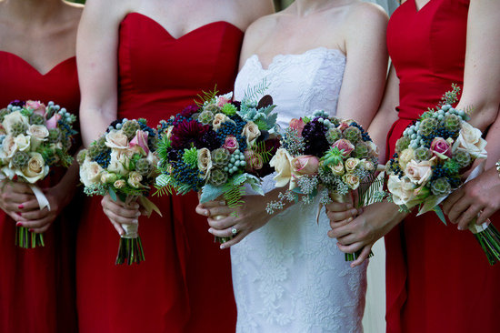 bride with bridesmaids in red sweetheart dresses romantic bouquets