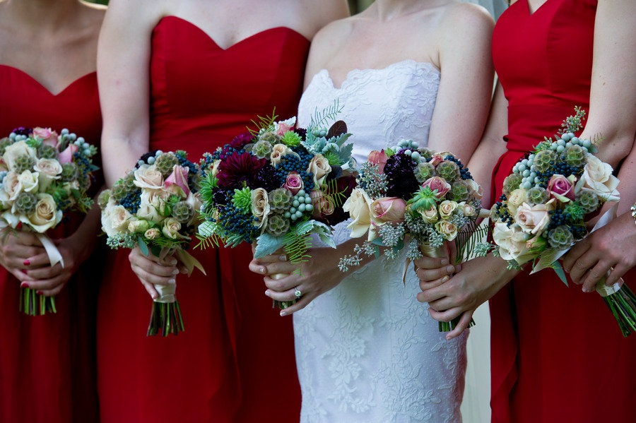 Bride-with-bridesmaids-in-red-sweetheart-dresses-romantic-bouquets.original