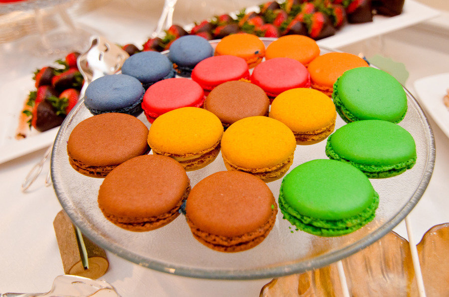 Bright-wedding-reception-dessert-display-macaroons.full