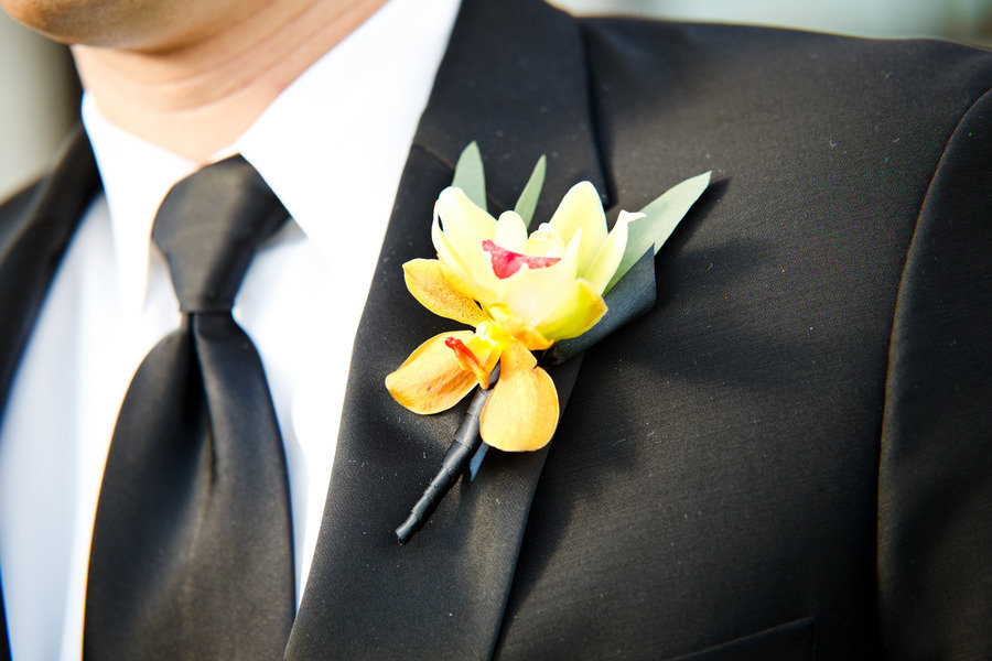 Yellow-orchid-grooms-boutonniere-real-wedding-photo.full