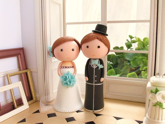photo of Wooden bride and groom cake topper