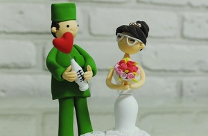 photo of Groom Doc with love syringe wedding cake topper