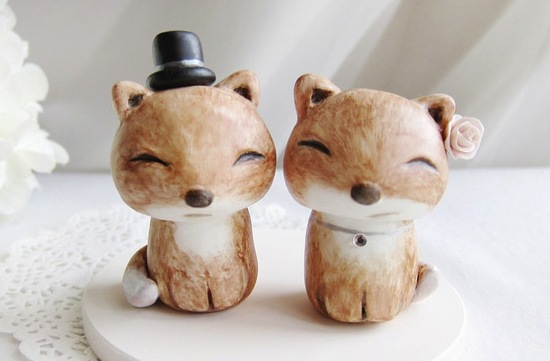 photo of Cute Fox bride and groom wedding cake topper