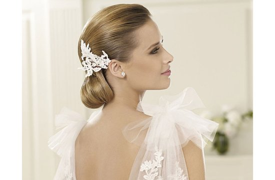 sleek vintage wedding hairstyle low bridal updo 2