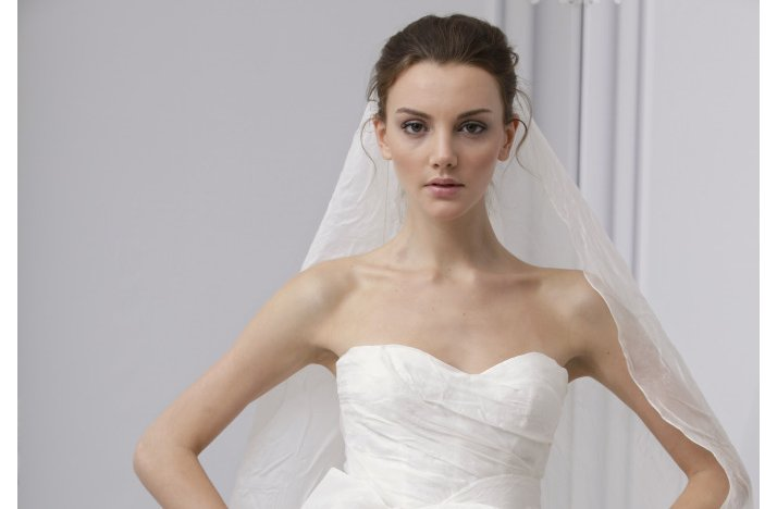 Wedding-hair-inspiration-romantic-bridal-updo-monique-lhuillier.full