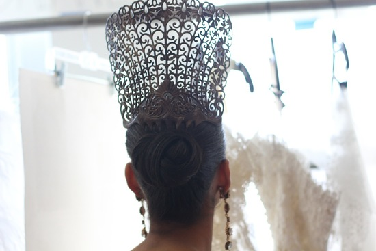 regal wedding hairstyle sleek bridal bun with crown