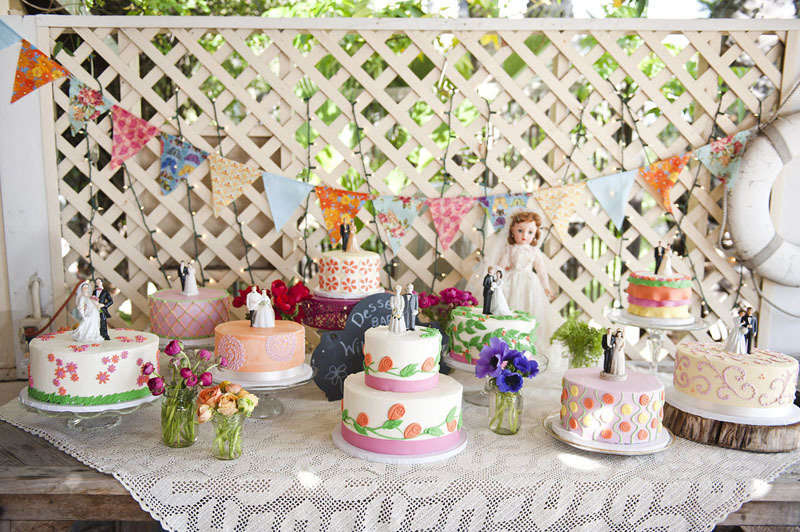 Vintage-real-wedding-outdoor-venue-multiple-cakes-and-toppers.full
