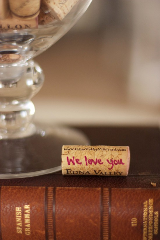 photo of unique wedding guest book ideas wine corks