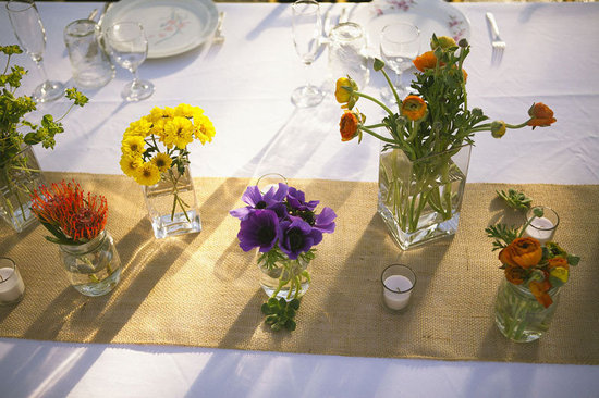 wildflower wedding centerpieces reception table decor yellow purple orange outdoor wedding 1