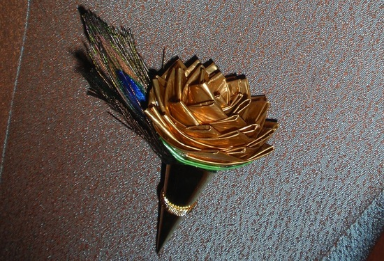 photo of Gold duct tape with peacock feathers groom's bout