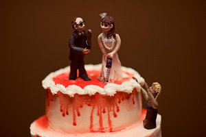photo of Bride and groom surrounded by zombies wedding cake topper