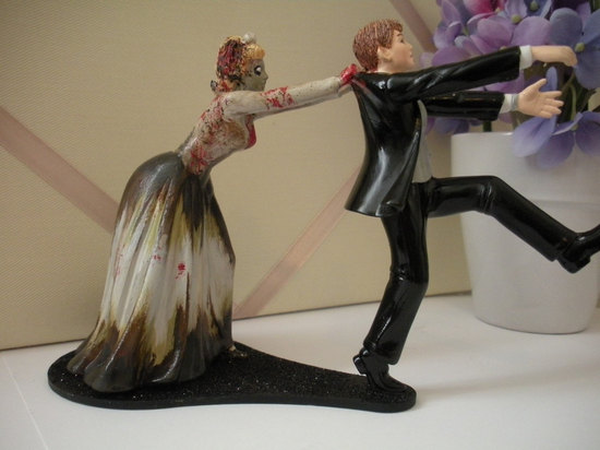 photo of Zombie Chaser wedding cake topper