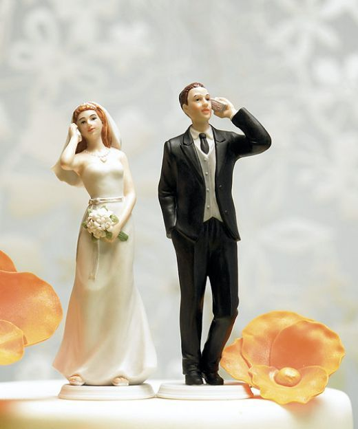 photo of get the prenup wedding cake topper