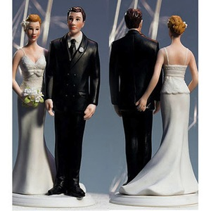 photo of love pinch wedding cake toppers