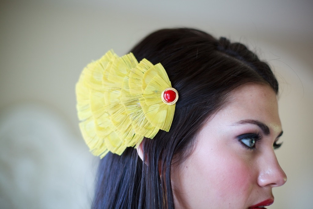 Yellow-wedding-hair-accessory-feather-fascinator-with-red-jewel.full