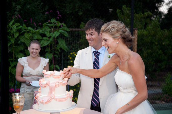 bow adorned wedding cake bride and groom