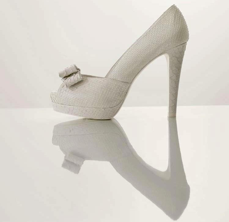 Splurge-worthy-wedding-heels-white-platform-bridal-pumps-with-bow-detail.full
