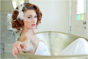photo of Lo Boheme bridal bow feather fascinator