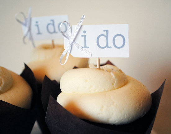 photo of Bow-adorned I Do wedding cupcake flags