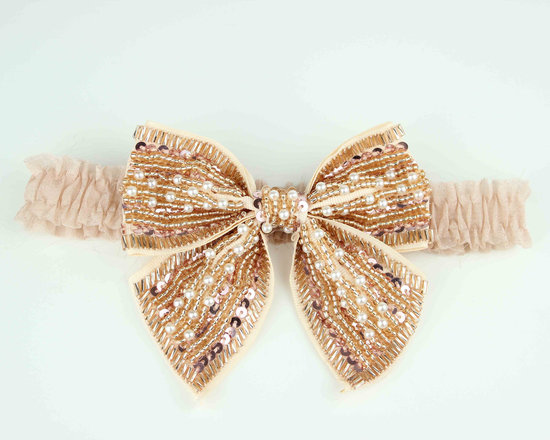 photo of Gold beaded bow bridal garter