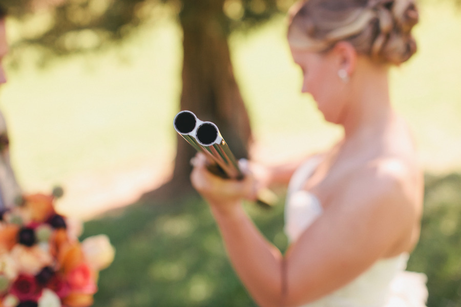 Romantic-outdoor-wedding-lace-decor-bride-with-gun.full