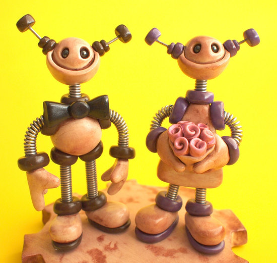 photo of Robot bride and groom wedding cake topper