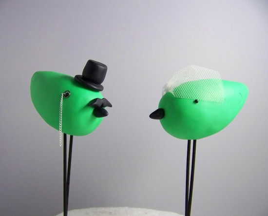 photo of Neon love birds wedding cake topper