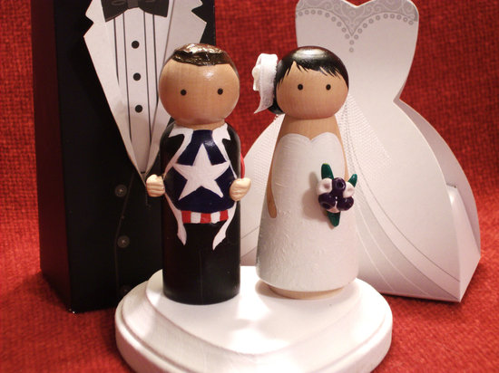 photo of Superhero groom wedding cake topper