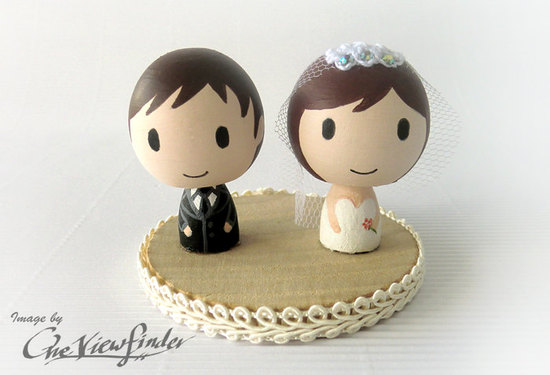photo of Cute couple wedding cake topper