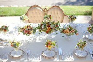 photo of romantic spring garden wedding flowers reception centerpieces 1