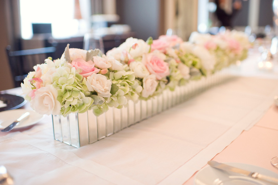 Spring wedding flowers soft pink green centerpiece