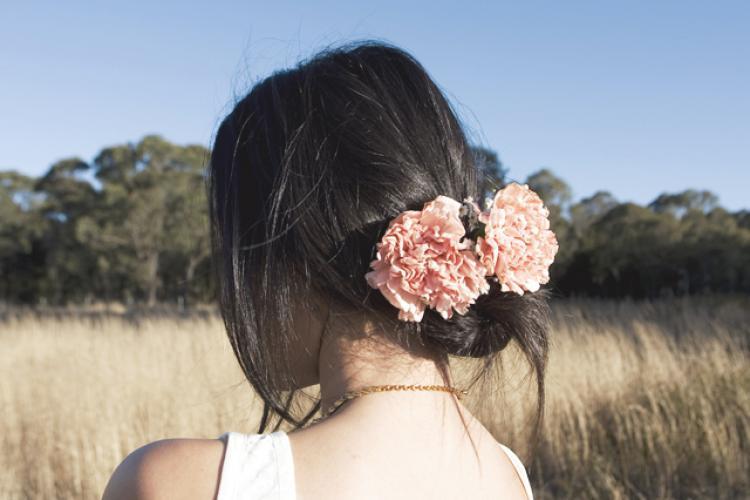 Loose-bridal-updo-romantic-wedding-hairstyles-pink-flowers-in-hair.full