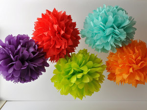 photo of Neon paper pom poms