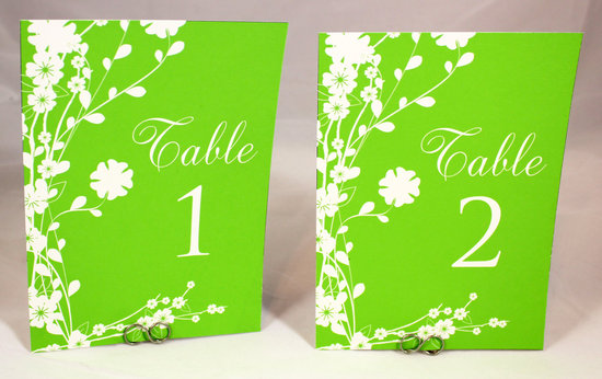 photo of Neon green wedding reception table numbers