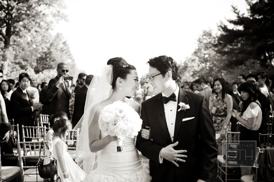 Bride-groom-look-lovingly-after-wedding-ceremony-vows.full