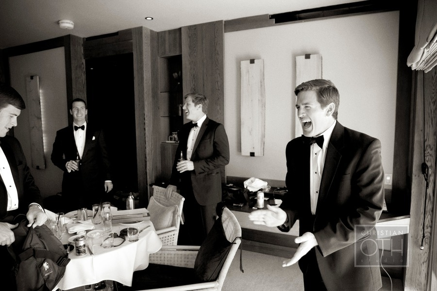 Groom-wears-formal-black-tux-laughs-with-groomsmen.full