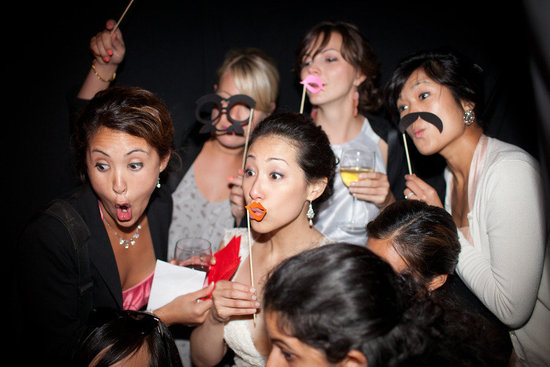 most memorable wedding photos bride with bridesmaids photobooth fun