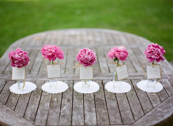 photo of romantic spring wedding outdoor venue simple centerpieces