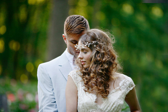 romantic all down bridal hairstyle with curls & flower crown