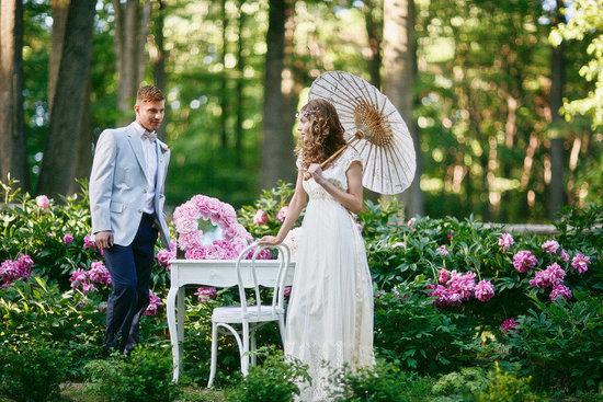 romantic spring wedding outdoor venue bride with parasol