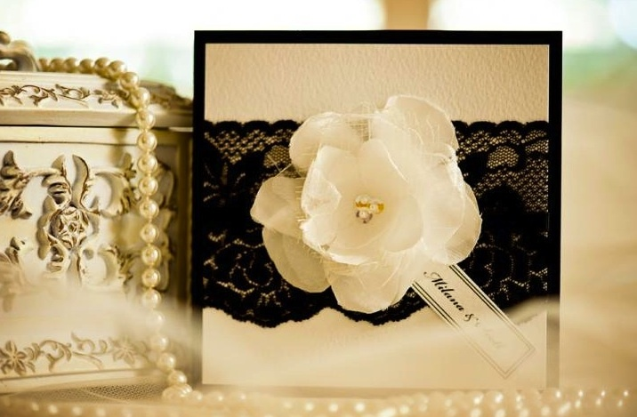 Elegant-wedding-invitations-with-black-lace-applique-and-floral-blooms.full