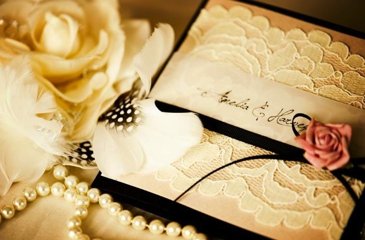ivory and black lace adorned wedding invitations