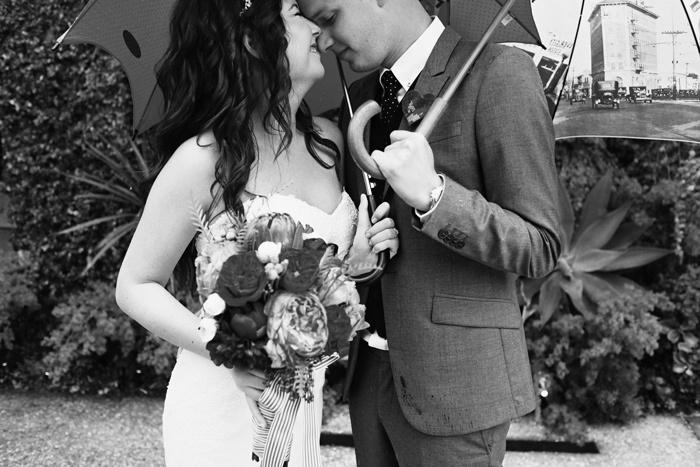 Bride-groom-pose-under-umbrellas-outdoor-wedding-love-theme.full