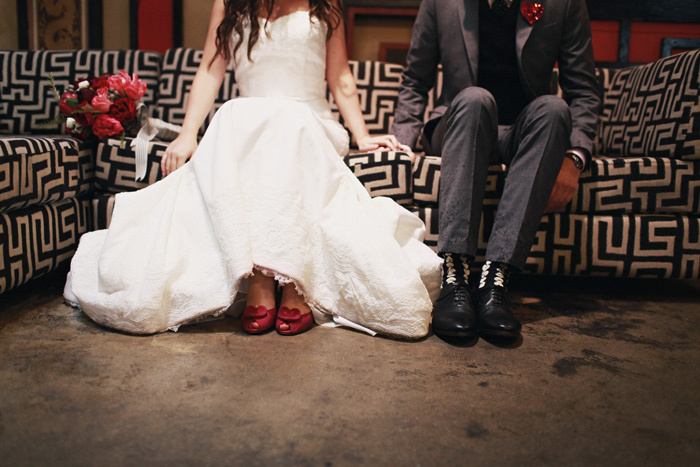 Bride-groom-show-off-wedding-shoes-love-themed-real-wedding.full