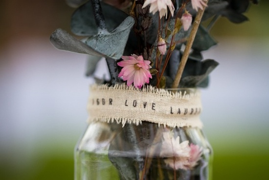 photo of romantic outdoor wedding spring wedding inspiration mason jar centerpieces