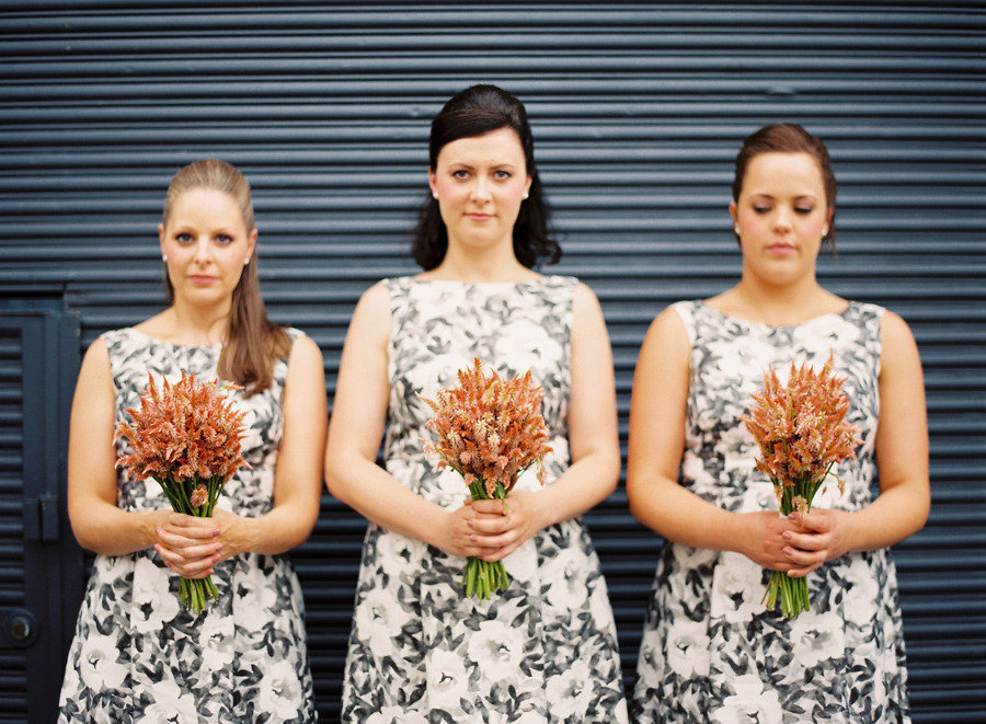 black white printed bridesmaids dresses orange bouquets
