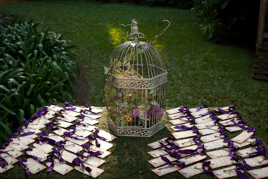 garden wedding escort card table purple white