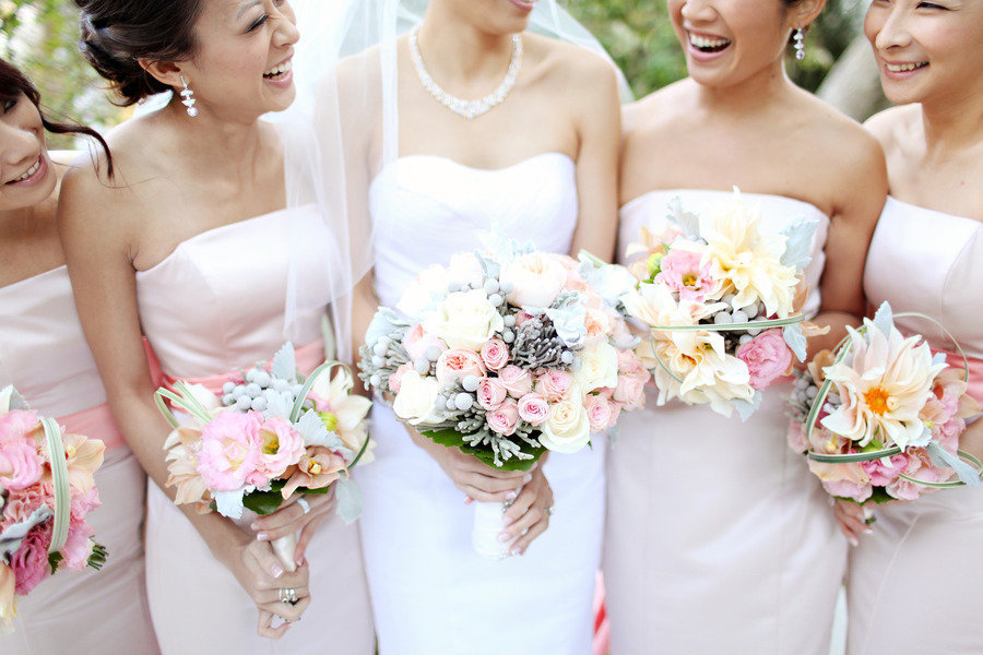 bride with bridesmaids light pink assorted bouquets