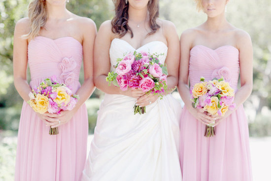 bride with bridesmaids pink long gowns romantic bouquets